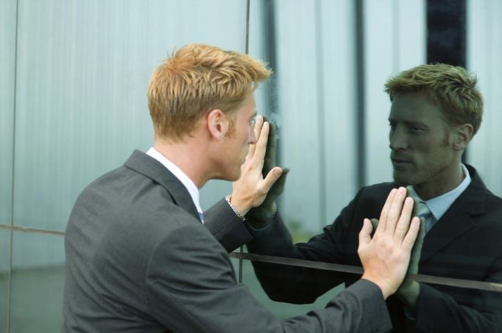 man-reflection-in-mirror