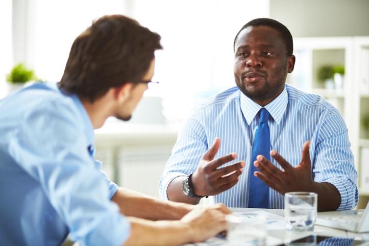 bigstock-two-managers-having-conversati-85239950