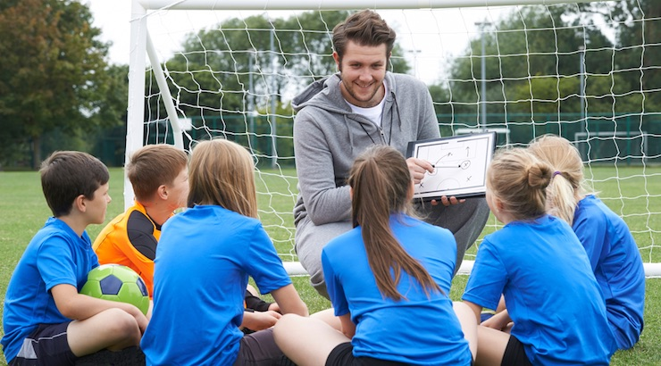 Soccer-coach-talking-to-young-players-.jpg